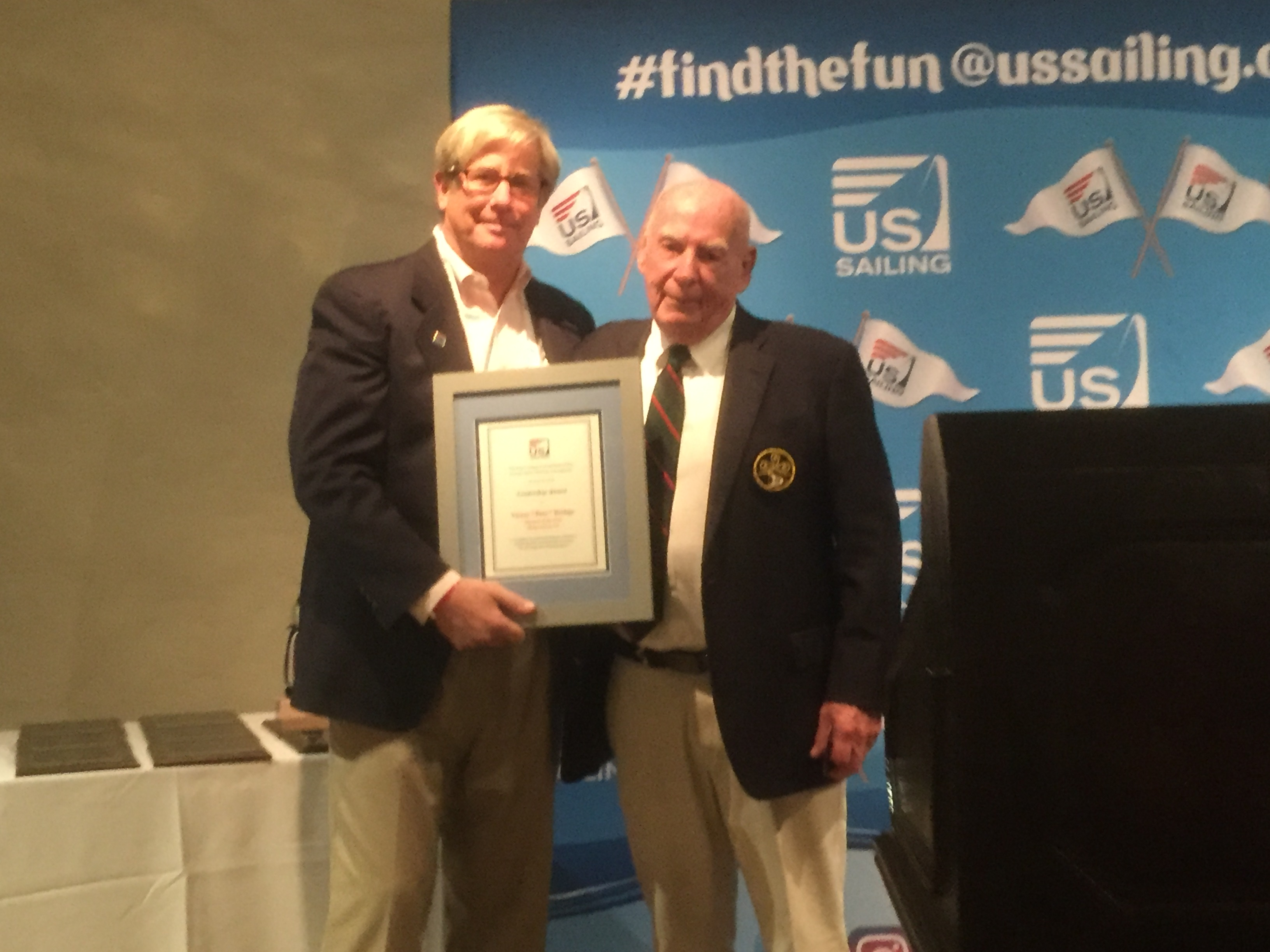Pete Bethge (R) receiving the National One-Design Leadership award from US Sailing VP Rich Jepsen